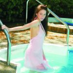 Bursa escort girl Alina enters the pool, her pink dress is still quite dry, but underneath it is already possible to see the slender girl's body. Alina looks straight into the camera