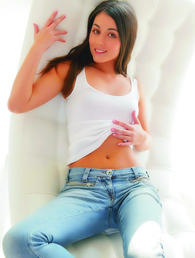 Escort bursa girl Lily is lying on the bed in blue jeans and a light shirt. The girl is very beautiful and sexy looking in a candid pose on bed