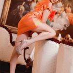 One of Whatsapp girls Lera is dressed in orange artificial leather and puts her leg higher to arouse you with her interesting look