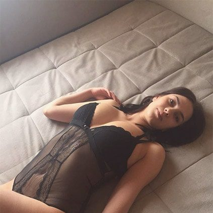 Bursa students escort Genechka is on the bed wearing semi-transparent black body costume, which devastatingly perfectly shows her curvaceous lines