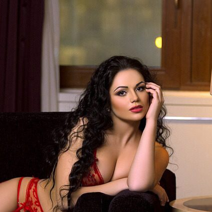 Russia incall escort Mariana in red underwear is lying in the couch
