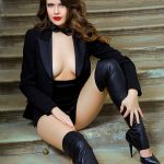 Outcall escorts Vlada in interesting apparel is sitting on stairs leading to her room
