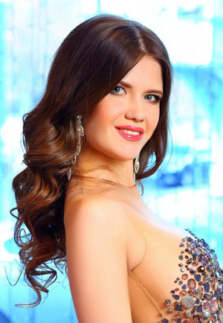 Outcall escorts Vlada gives a half-turn profile picture in an evening dress