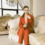 Outcall escort service girl Ksyusha in the fancy living room showing her porcelain-white face