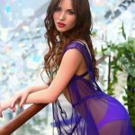 Russia outcall escort Kira in the blue thin-cloth gown is on the balcony of a hotel