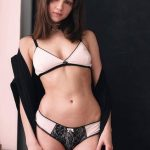 Incall escorts in Bursa Olga in the white-and-black underwear with a shawl on her shoulders