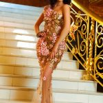 Russia outcall escort Kira is on the stairs of a fabulous building in the glossy sparkling dress