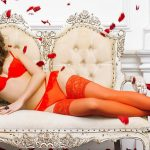 Outcall escorts Vlada in everything red is in the bright bed making a contrast